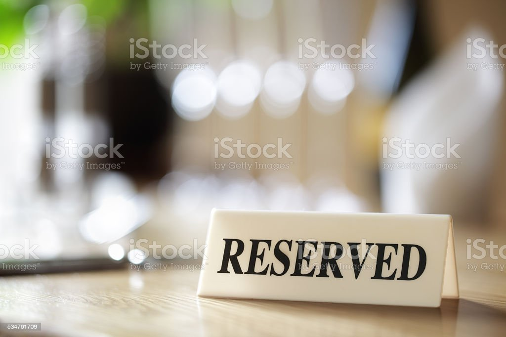 Reserved sign on restaurant table stock photo