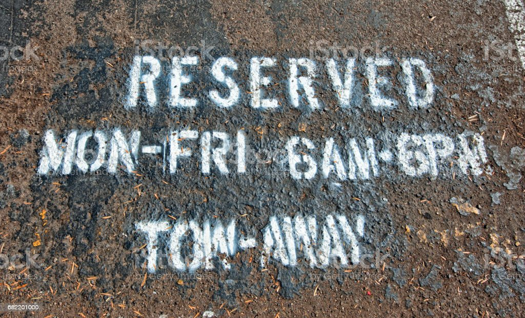 Reserved sign painted on ground stock photo
