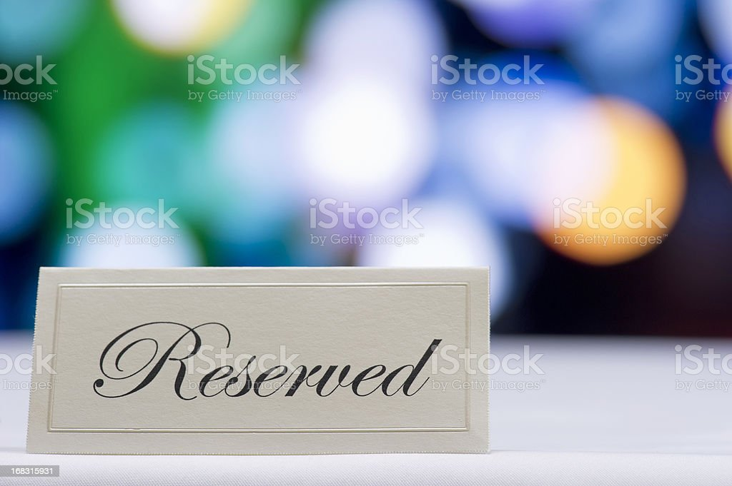 Reserved sign  with defocused lights in the background stock photo