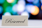 Reserved sign  with defocused lights in the background