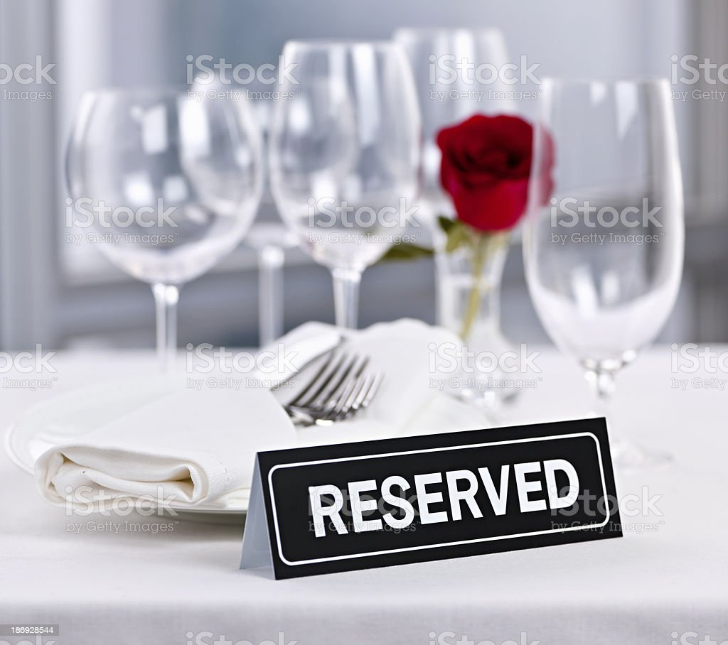 Reserved table at romantic restaurant stock photo