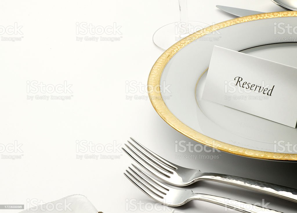 Reserved table tent on top of table setting royalty-free stock photo