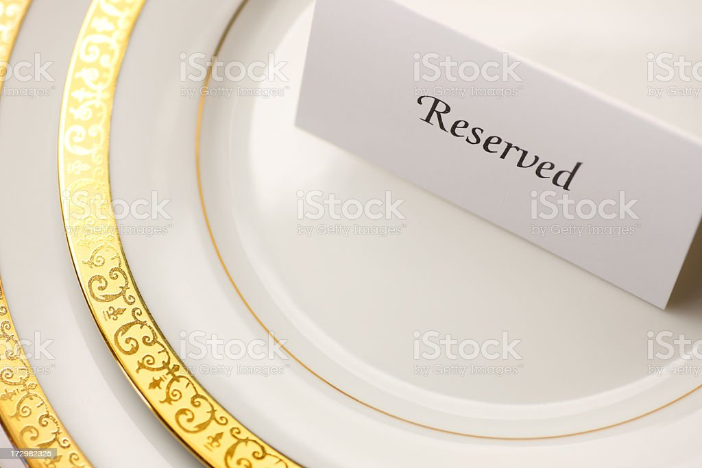 Reserved table tent on top of table setting stock photo