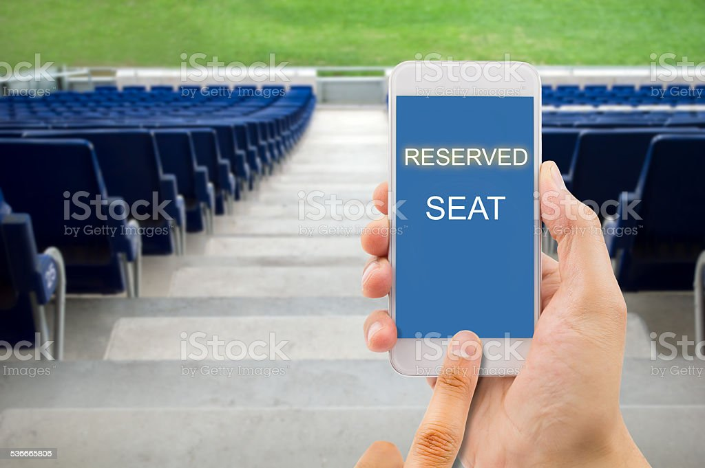 reserving a seat with a smart phone stock photo