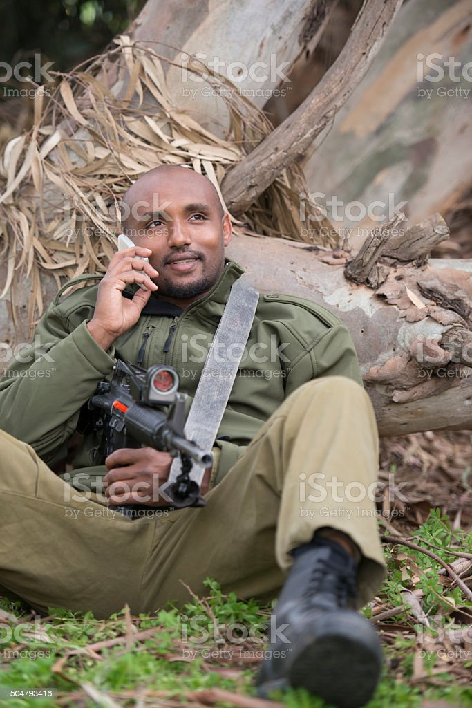 Reservist using cell phone. stock photo
