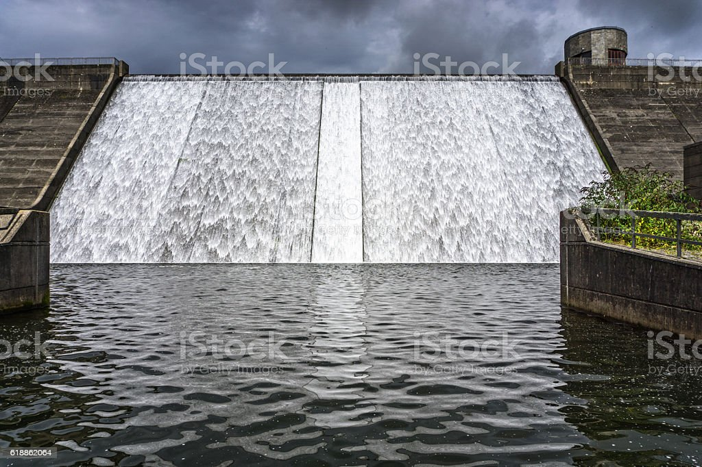 Reservoir overflow weir in remote Welsh countryside stock photo