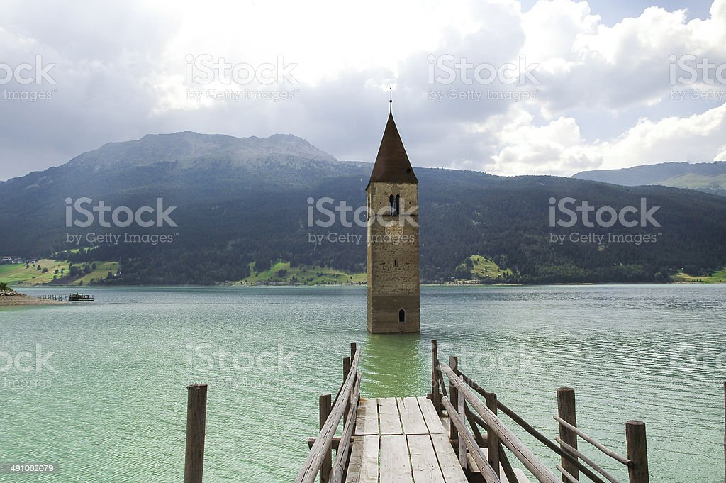 Resia, tower in the lake stock photo