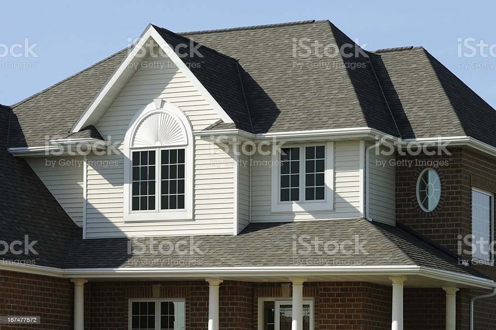 Residence, Home With Vinyl Siding, Brick, Gabled Architectural Design royalty-free stock photo