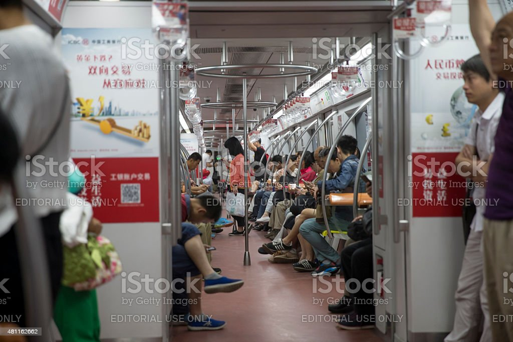 Residence ride the subway to work in the moring, Beijing stock photo