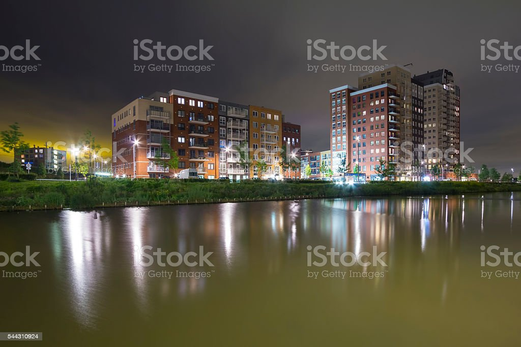 Residential appartment complex at night stock photo