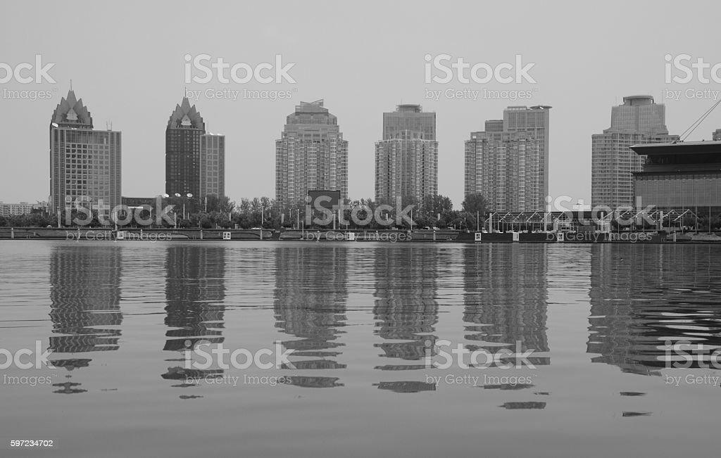 Residential buildings reflecting on Lake, Zhengzhou, China stock photo