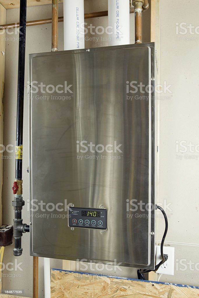 Residential Condensing Hybrid Tankless Water Heater stock photo