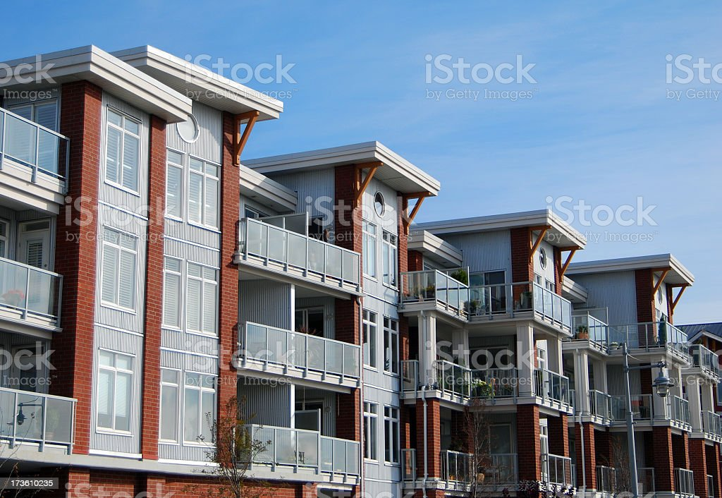 Residential condos photographed against blue sky stock photo