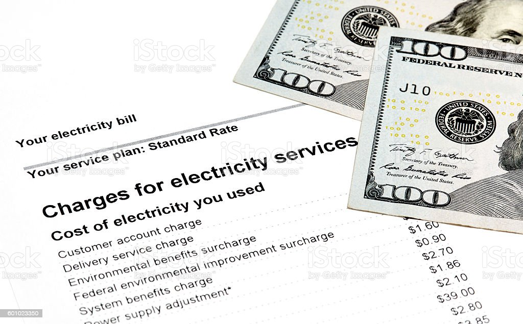 Residential Electricity Bill with US Currency stock photo