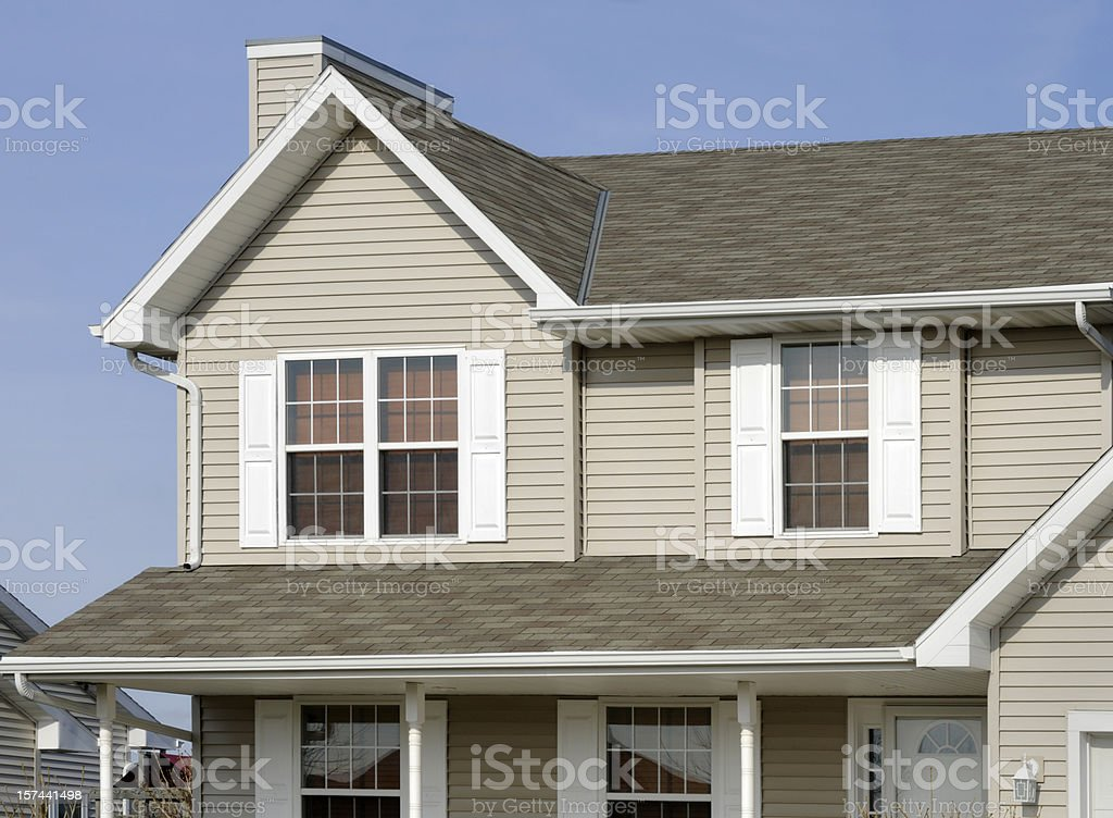 Residential Home With Vinyl Siding, Gable Roof, Seamless Gutters, Shutters stock photo