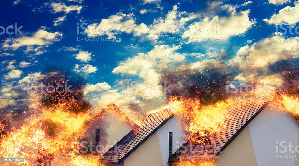 Residential homes on fire stock photo
