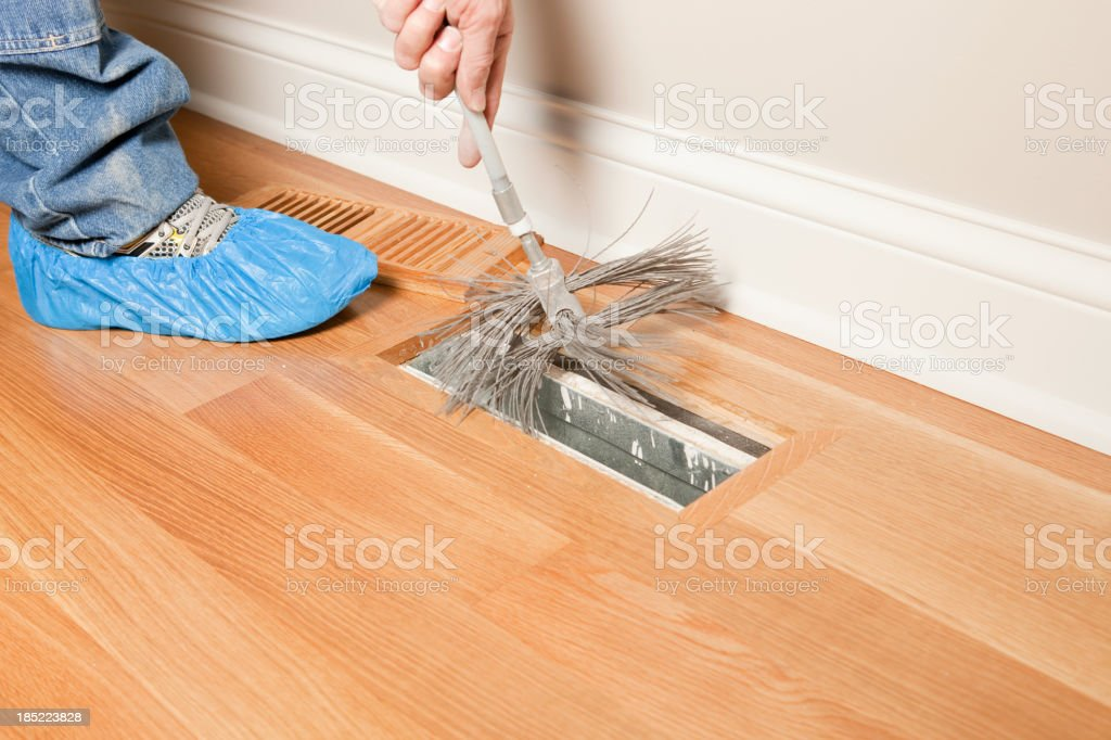 Residential HVAC Duct Cleaning with a Power Brush stock photo