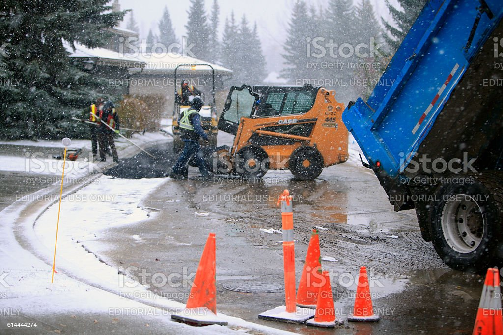 Residential Road Construction In Blizzard Conditions stock photo