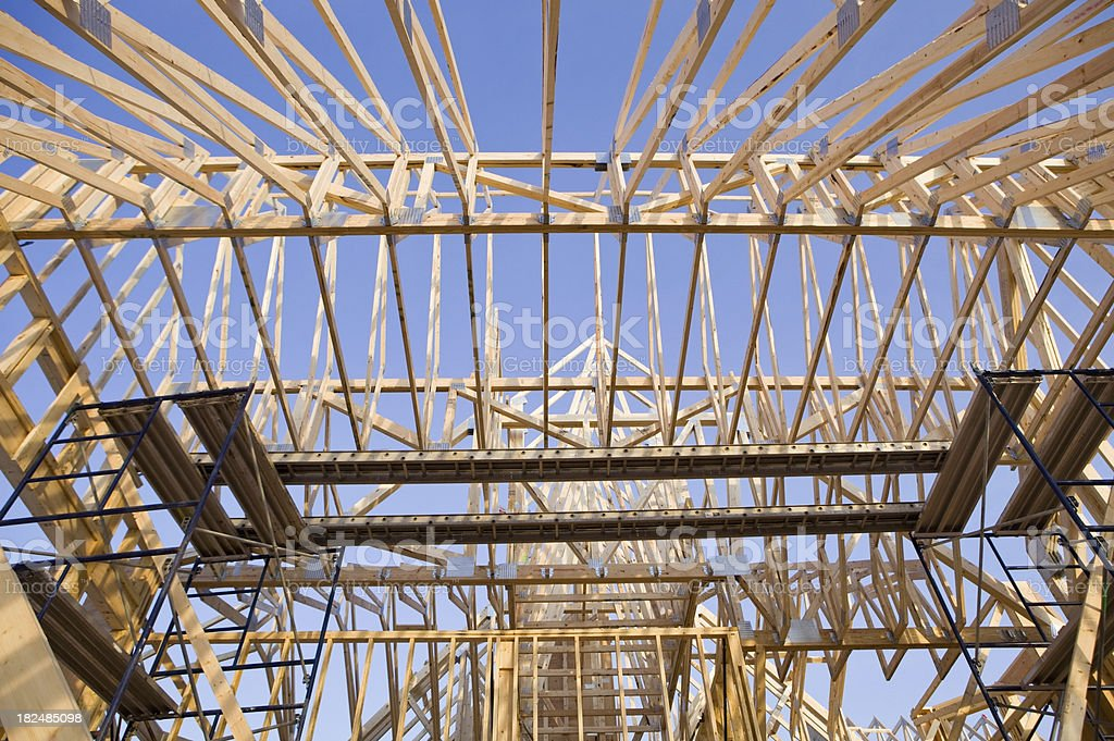 Residential Roof Trusses Leading to Clear Blue Sky from Inside royalty-free stock photo