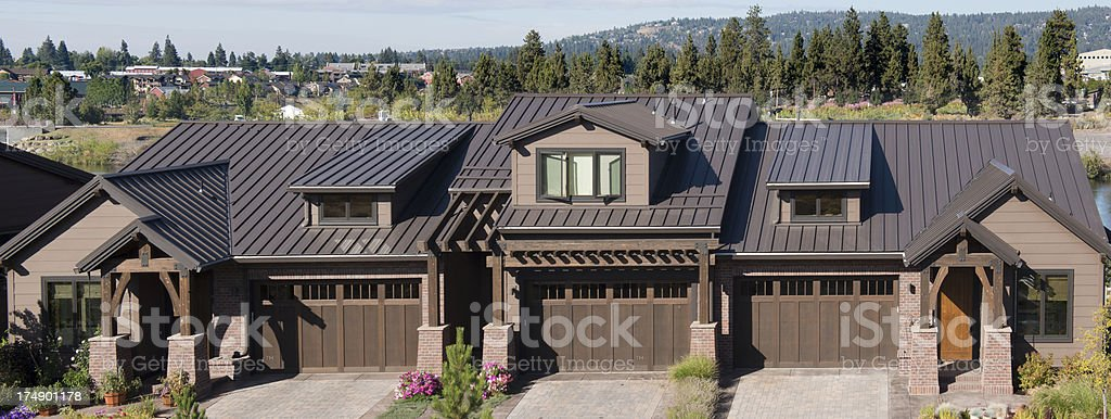 Residential steel roofing installation stock photo