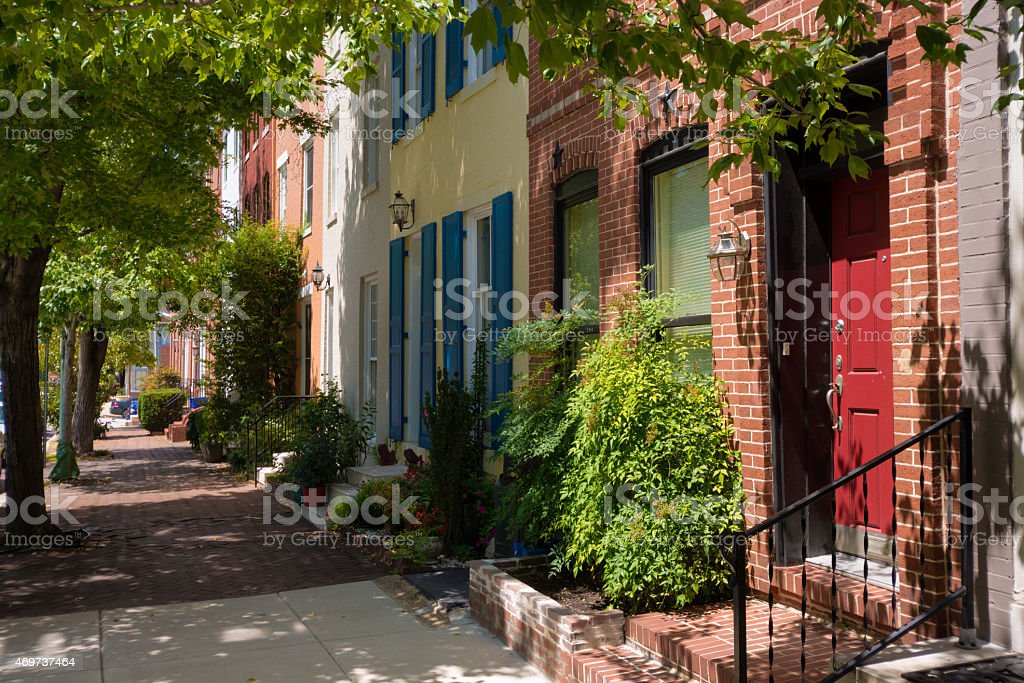 Residential street and sidewalk in Baltimore, MD stock photo