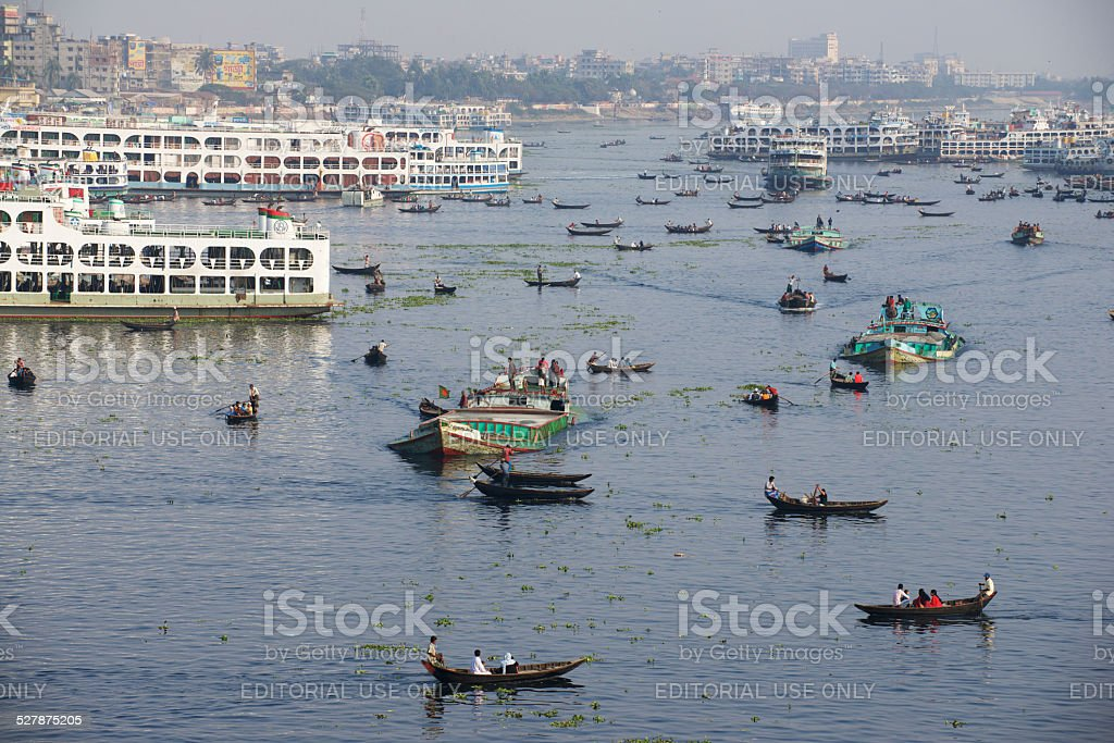 Residents of Dhaka cross Buriganga river by boats, Bangladesh stock photo