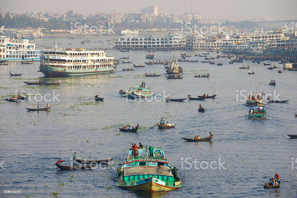 Residents of Dhaka cross Buriganga river by boats. stock photo