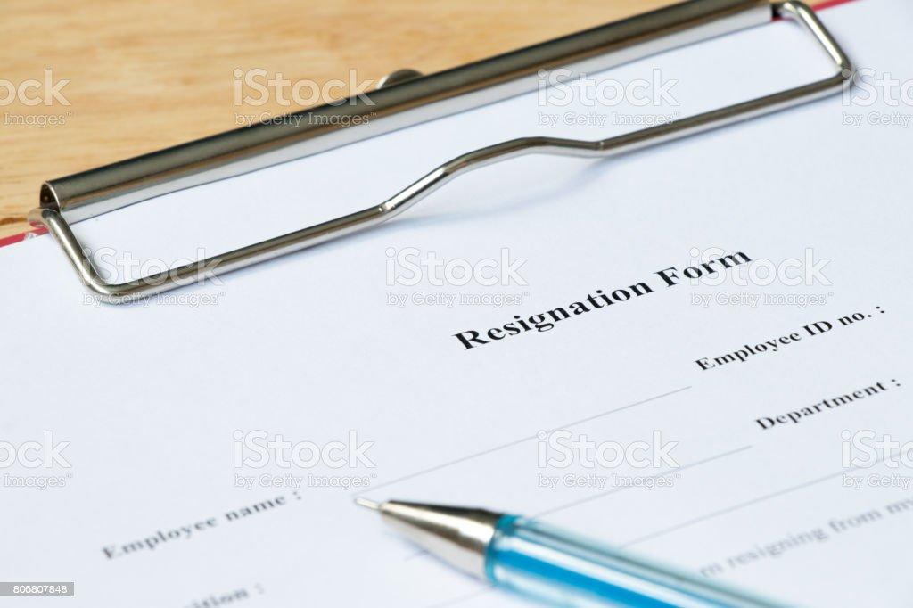 Resignation form on wood desk background stock photo