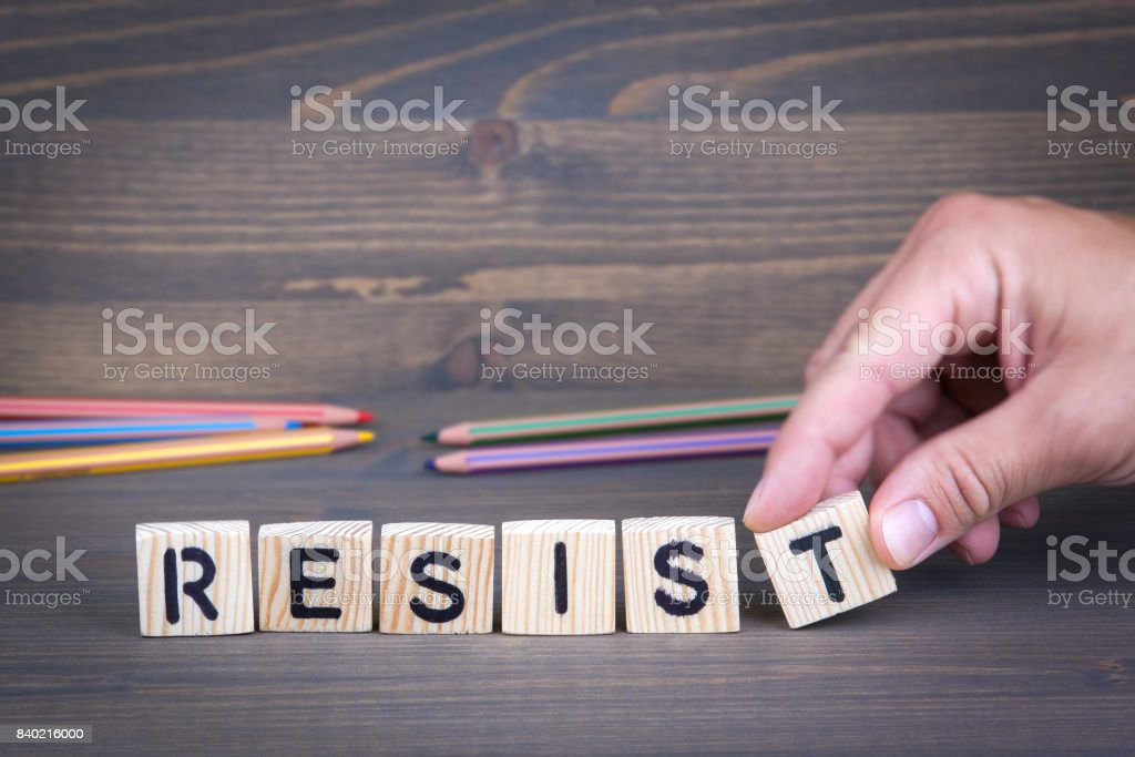 Resist from wooden letters on wooden background stock photo