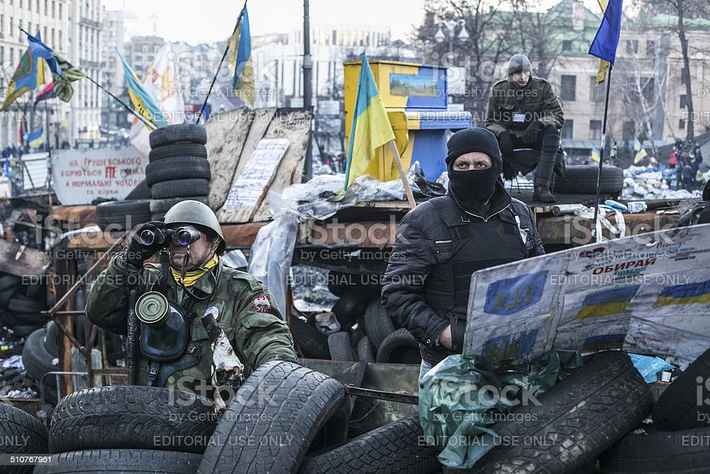Resistance fighters guarded the barricade in Kiev stock photo