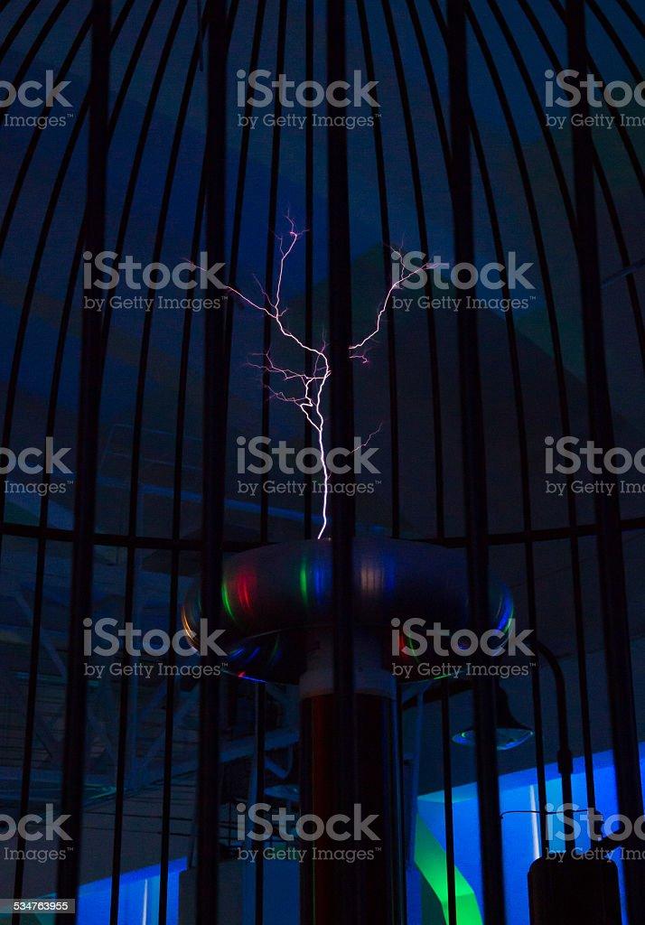 Resonant transformer in work. Tesla coil. stock photo