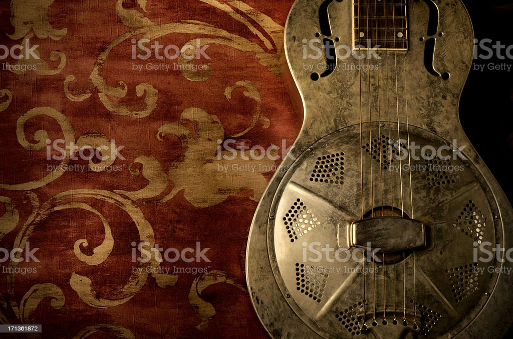 Resonator Guitar on Red Background stock photo