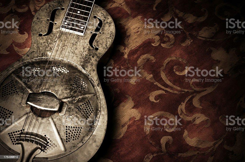 Resonator Guitar on Red Background stock photo