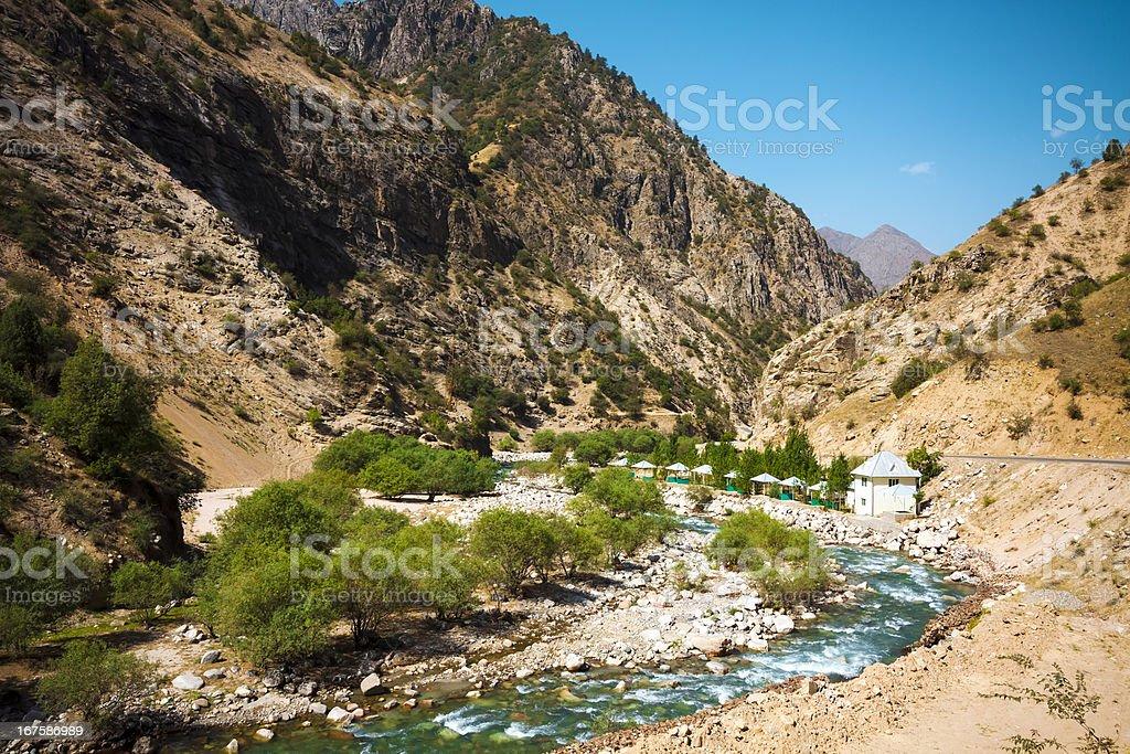 Resort along Mountain moraine river royalty-free stock photo