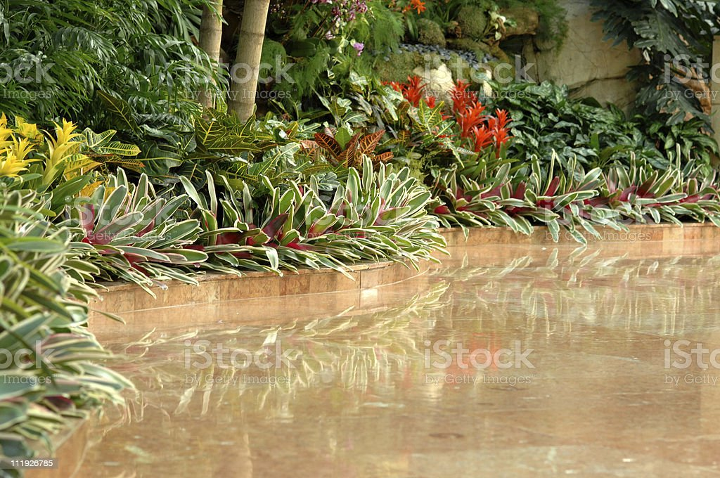Resort Hotel Lobby with Reflective Marble Floor and Plants royalty-free stock photo