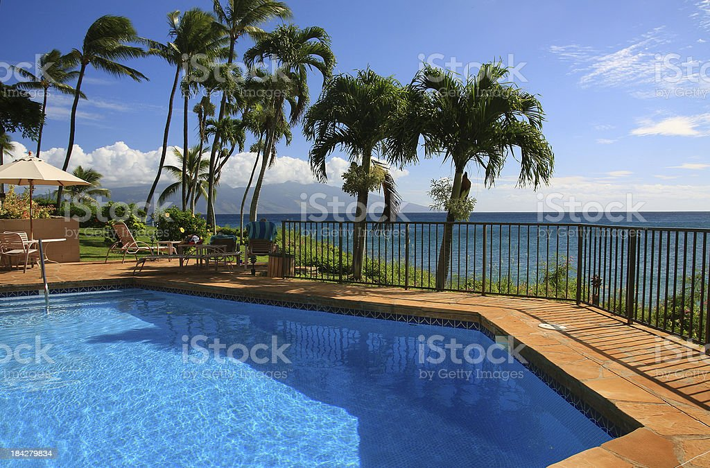 Resort hotel swimming pool and palm trees on Maui Hawaii royalty-free stock photo