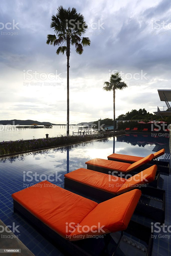 Resort pool and beds royalty-free stock photo
