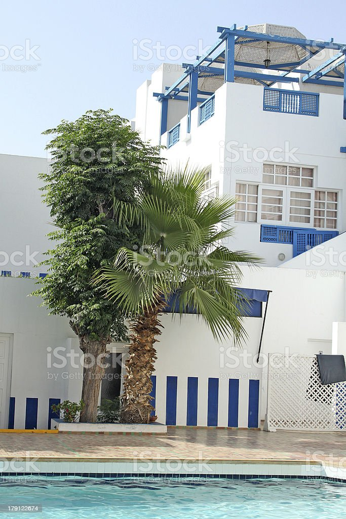 Resort with swimming pool and palms royalty-free stock photo
