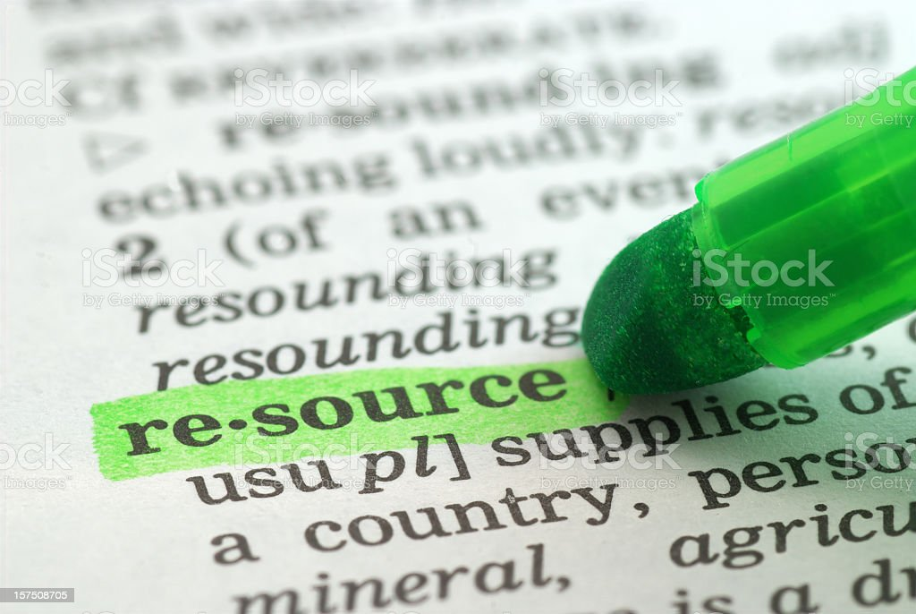 resource highligted in dictionary stock photo