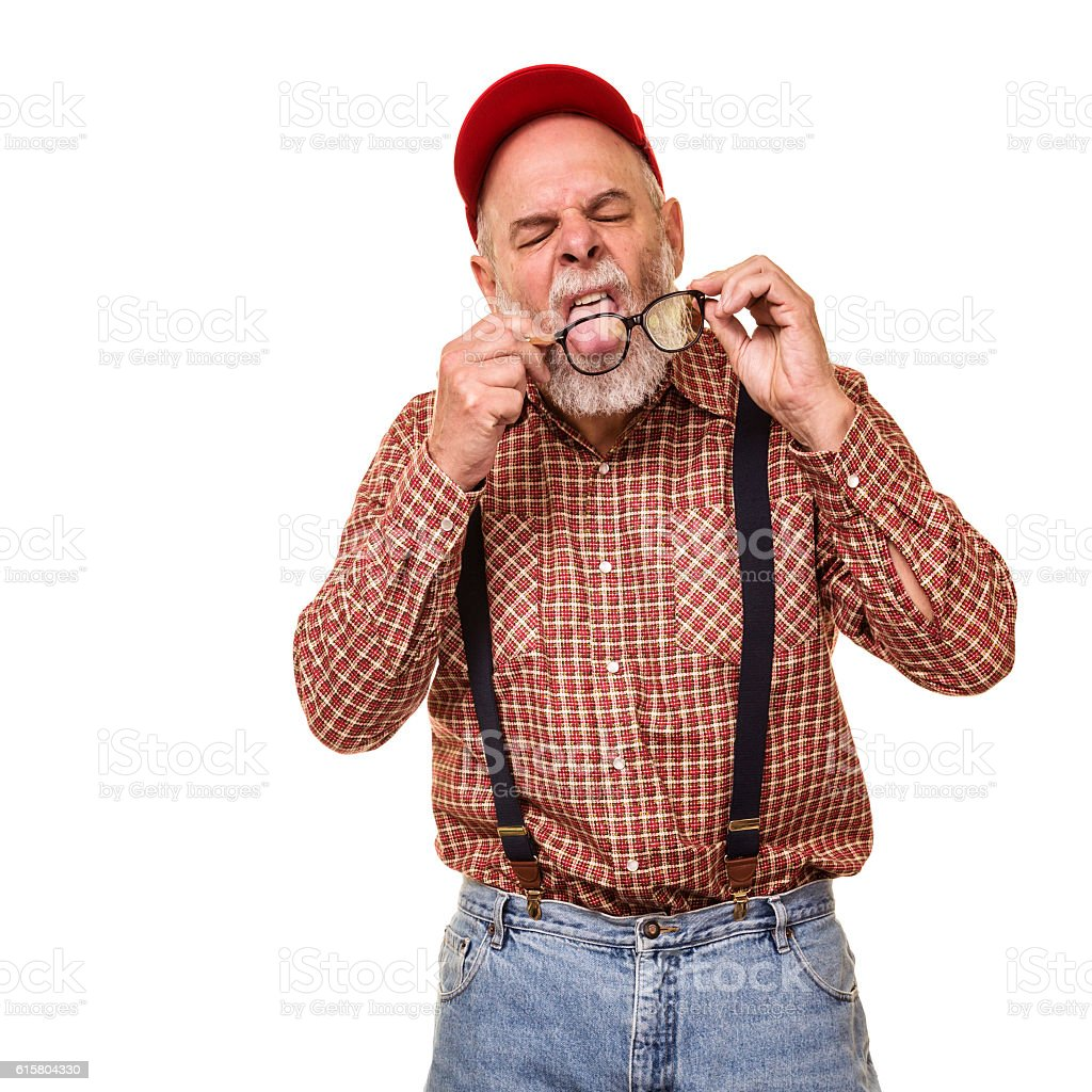 Resourceful Redneck Hillbilly Man Licking Eyeglasses To Clean Them stock photo