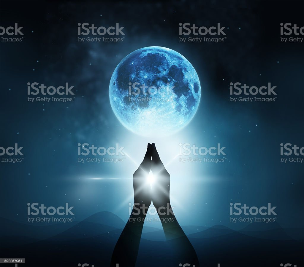 Respect and pray on blue full moon with nature background stock photo
