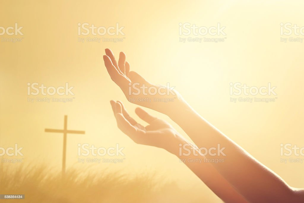 Respect and pray on the cross and nature sunset background stock photo