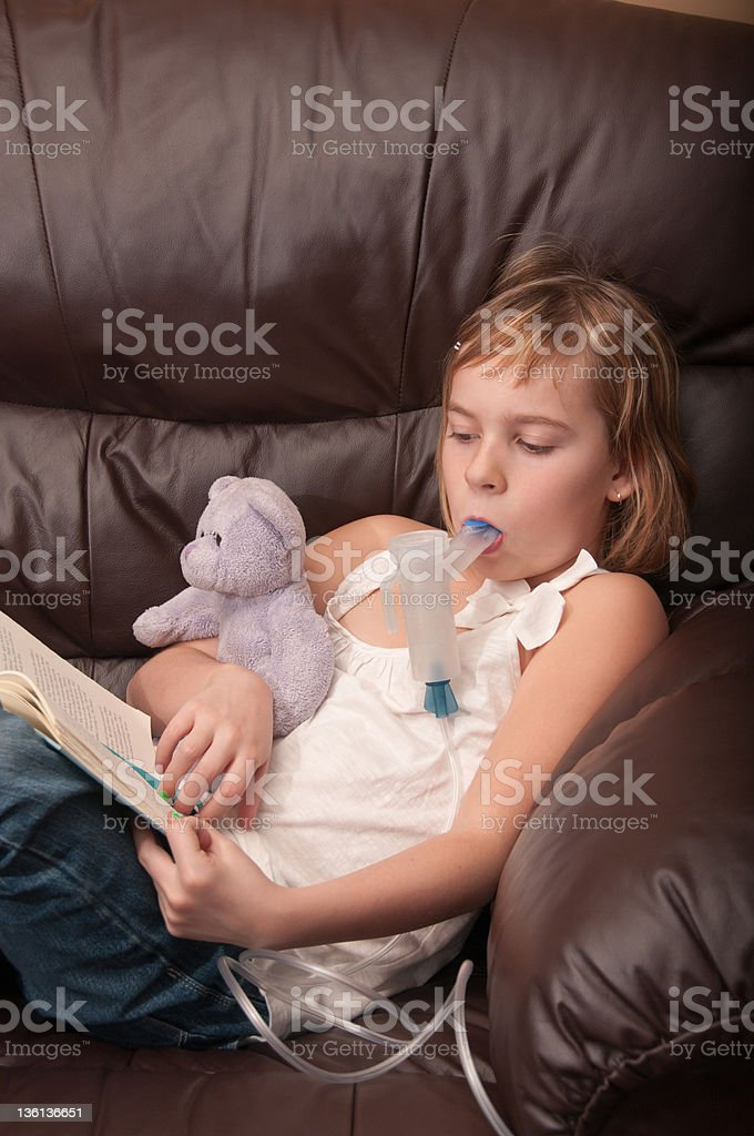 Respiratory inhaled antibiotic therapy with best friend and a book stock photo