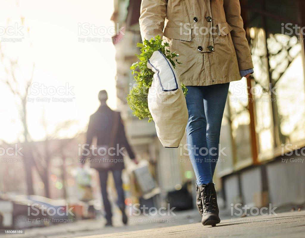 Responsible Shopper using a Reusable Grocery Bag stock photo
