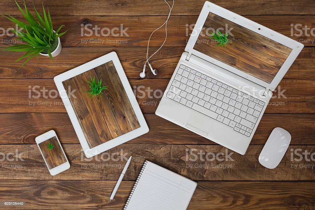 Responsive Design Theme Example Electronic Gadgets on wood Background stock photo
