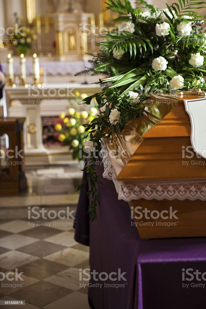 Rest In Peace - simply wooden coffin at church stock photo