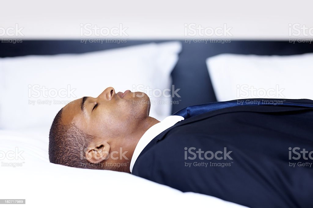 Rest in peace - Young business man sleeping on bed royalty-free stock photo