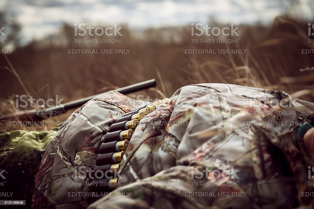 Rest in rural field at sunset after  hunting day stock photo