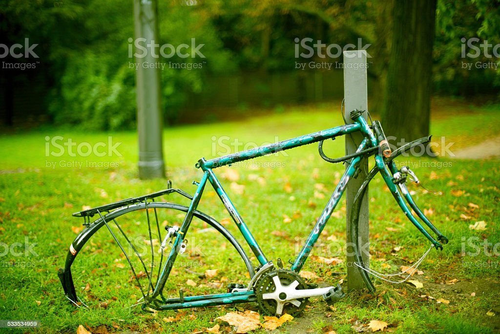 rest of an old bicycle after theft stock photo