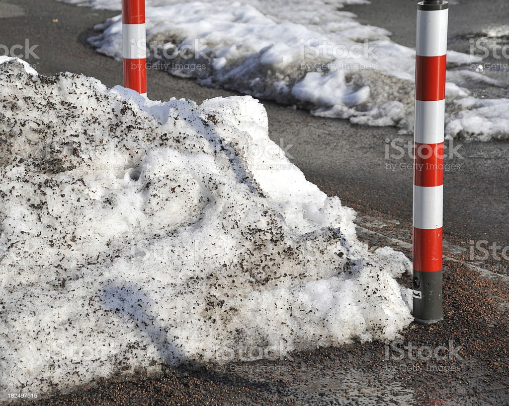 rest of dirty snow near street with road salt de-icing stock photo